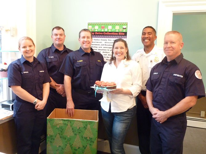 Occasionally Cake owner Sabrina Campbell is joined by firefighters Megan Rowan, Dale Barr, Phil Perry, Willie Bailey and Tim Curley Nov. 27 to kick off the 2012 Firefighters and Friends Holiday Toy Drive. The store will be collecting new, unwrapped toys for distribution by firefighters to local nonprofits and schools serving children in need.