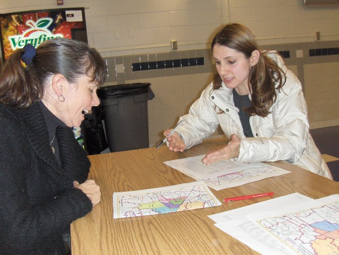 (From left) Parents Tina Steblein and Reem Akkad talk about potential effects of the boundary changes.