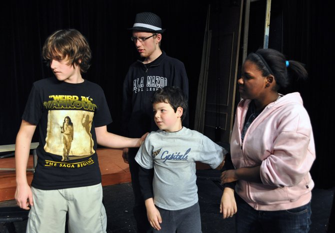 "From left, Blake Phillips as Ralph Herdman, Ryan Clark as Leroy Herdman, Brendan Dure as Charlie Bradley, and Jody Parker as Imogene Herdman in rehearsal for the Providence Players of Fairfax production of ""The Best Christmas Pageant Ever."""