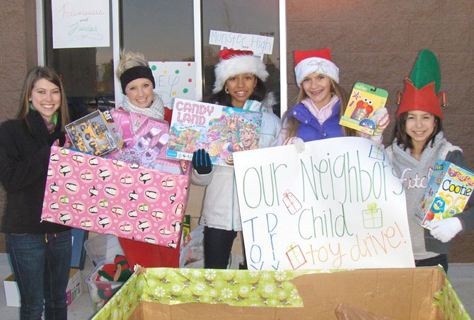Collecting new toys for Our Neighbor's Child, last year, outside the Fair Lakes Wal-Mart are (from left) Taylor Kim, Brooke Caskey, Brianna Crump, Katie Barta and Cristina Sturniolo. Caskey assisted ONC Executive Director Kelly Lavin, and the others were on the competition team of Creative Dance Center of Chantilly.