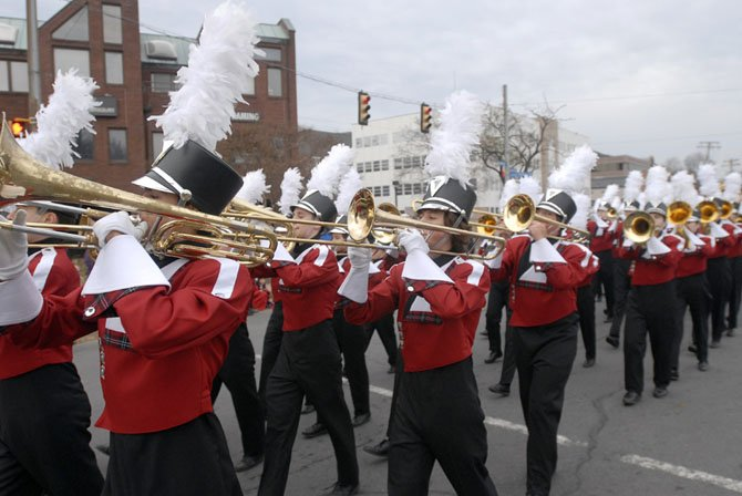 The McLean High School Marching Band participates in the 5th Annual WinterFest Parade in McLean on Sunday evening.