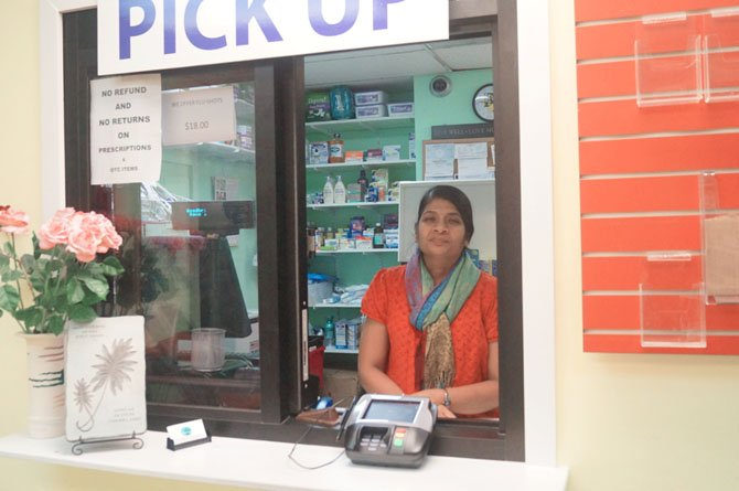 Kamini Shah greets customers at the pick-up desk and said she enjoys interacting and developing relationships with them.