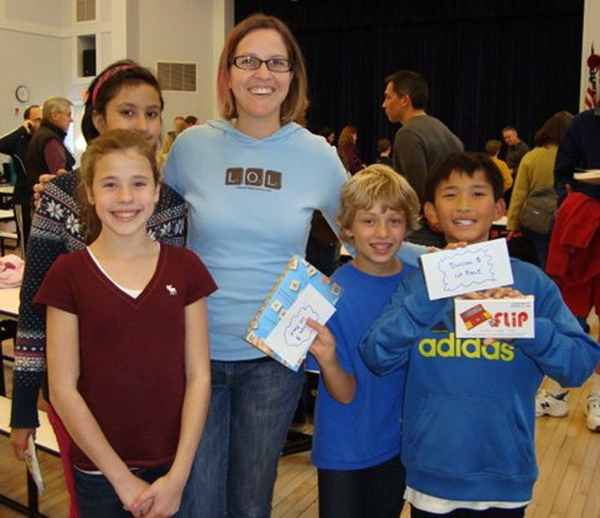 Churchill Road Scrabble team members Anna Krause-Steinrauf, Ladan Haidarbaigi, Tanner Iverson and Ethan Pham pose with club sponsor Ms. Jenny Whiteman at the conclusion of the tournament.