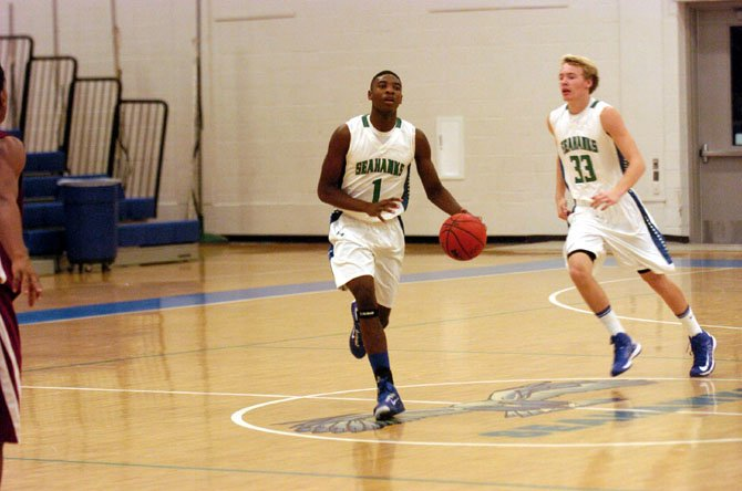 South Lakes sophomore Brandon Kamga scored 20 points against Oakton on Nov. 29.