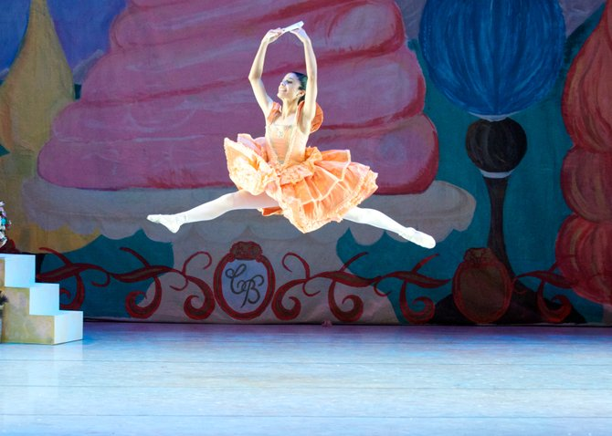 "Senior Zahra Mahbub sashays, turns, leaps and flutters her fan with a passion that wins admirers throughout the theater in the Conservatory Ballet's 40th anniversary production of the holiday classic, ""The Nutcracker."""