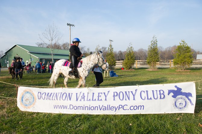 The Dominion Valley Pony Club, a local youth equestrian organization, provided pony rides at the Frying Pan Farm Park Old-Fashioned Holiday Celebration on Saturday, Dec. 1.