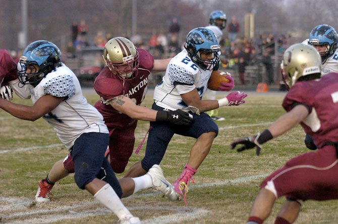 Oakton defensive lineman Joe Allely reaches for L.C. Bird running back Paul Robertson during the Division 6 AAA state football semifinals on Saturday, Dec. 1 at Oakton High School.