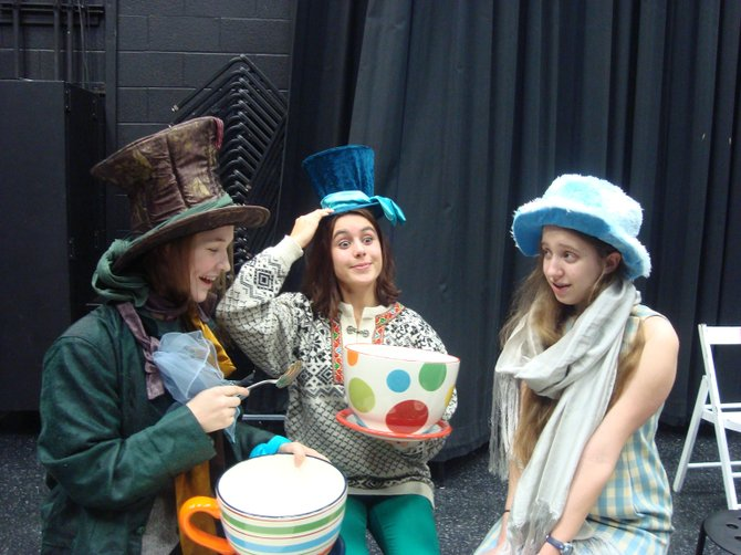 "The characters of ""Alice in Winter Wonderland,"" Cleo Allen-Mills as the Mad Hatter, Isabel Zapata & Lily Lord (Alice) at tea."