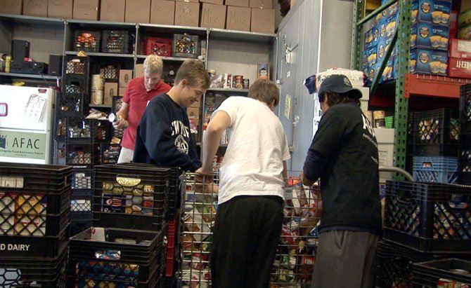 Volunteers organize the food shelves at the Arlington Food Assistance Center.