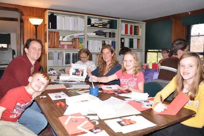 From left: Alexander, Zoe, Bill, Elsa and Kiera Vincent, and Mary Anna Vineyard make greeting cards.