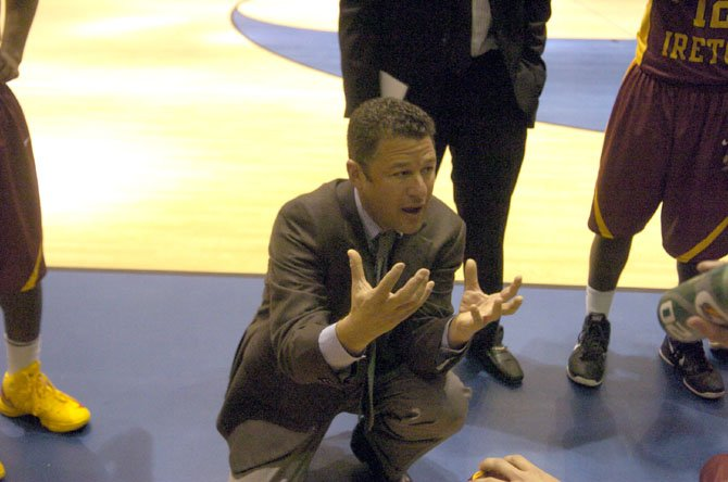 Bishop Ireton head boys' basketball coach Neil Berkman talks to the Cardinals during a game against Fairfax on Dec. 3.