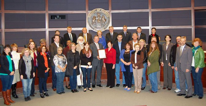 The Board of Supervisors designated Dec. 14, 2012, as Jeans Day in Fairfax County at their Dec. 4 meeting. (Center) Jim Corcoran, president of The Fairfax Chamber of Commerce, holds the proclamation with Board of Supervisors Chairman Sharon Bulova.