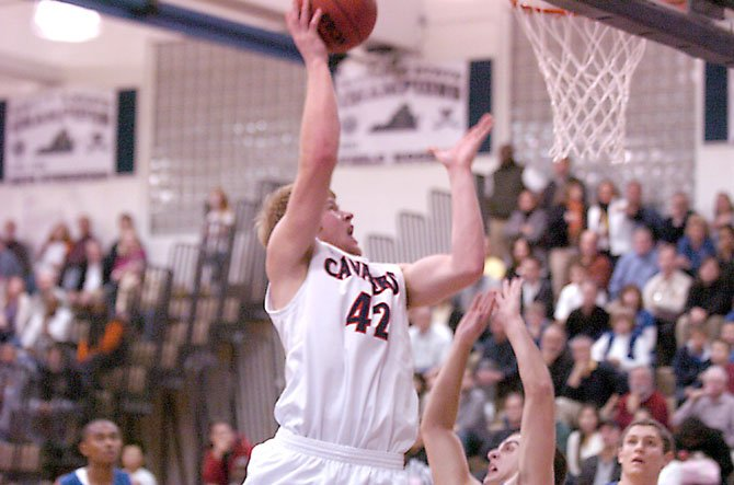 Woodson junior Andy Stynchula can make an impact in the paint or around the perimeter.