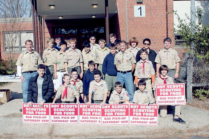Boy Scouts from Clifton Troop 1104 take a break and pose for a picture during their annual food drive event.