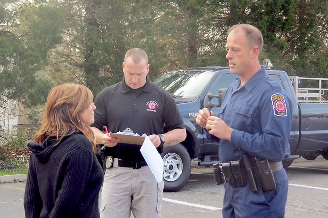 Academy instructors PFC Richard Cash and PFC Liz Barrington demonstrate a mock DWI case as another officer takes notes.