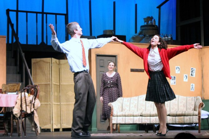 Catherine Ariale and Drew Holcombe dance as Anne and Otto Frank as Rachel Steiner (Mrs. Van Daan) watches.