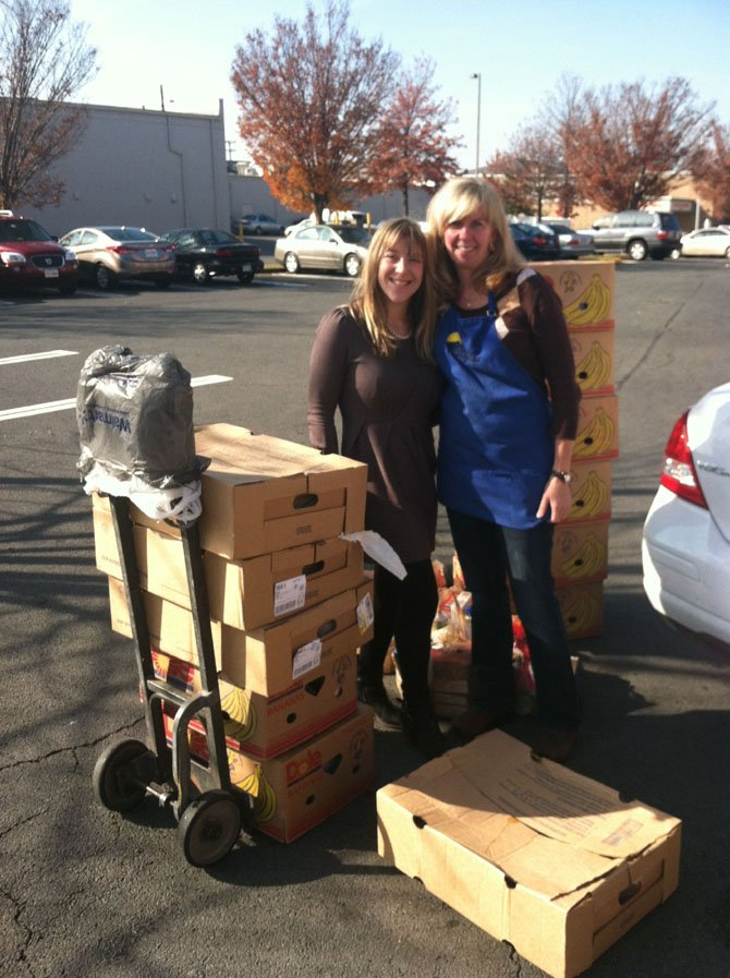 From left are JoAnna Goldberg, director of marketing at Storage Village Self Storage, and Terri Kelly, manager of WFCM's Food Pantry, accepting the Thanksgiving Food for WFCM clients.