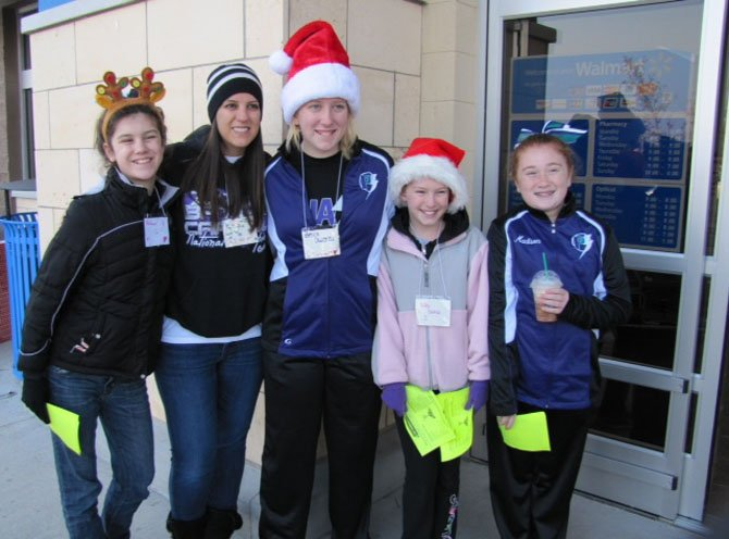 From left are Rebecca Gallagher, Joy Hansen, Becca Owens, Kelly Domas and Madison O'Neill of Phase Cheer & Dance outside the Fair Lakes Walmart.