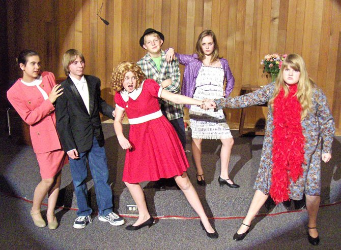 "Rehearsing ""Annie"" are (back row, from left) are Sean Luffy and Molly Van Trees; and (front row, from left) are Isabelle Bingham-Wright, Jacob Dietz, Aubrey Cervarich and Maggie Deely."