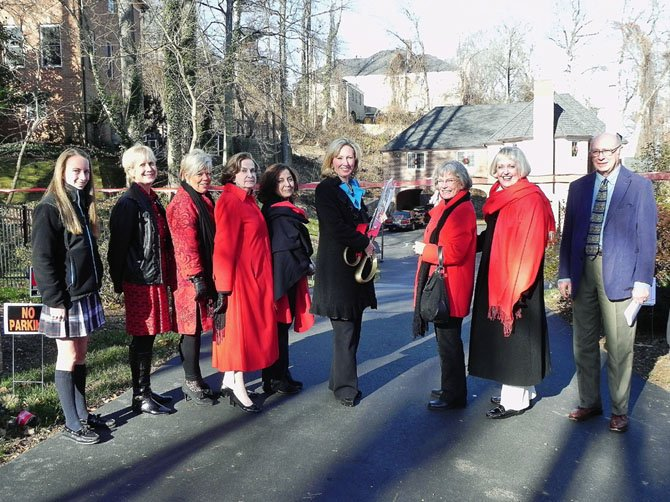 Pictured, from left, Diana Simione, a student from McLean's Oakcrest School, who assisted in the tour; Woman's Club member Cathy Kelly, McLean Chamber of Commerce Chairman Marcia Twomey, tour Co-Chairman Rosemarie Lazo, tour homeowner Bushra Sangid, Del. Comstock, tour Chairman Kathlyn Burnell, Woman's Club President Virginia Sandahl and Roger Kilton, a homes tour visitor and supporter.