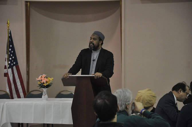 Imam Mohamed Magid, executive director of the All Dulles Area Muslim Society, speaks on the importance of faith in peace Feb. 3, 2011, during the ADAMS commemoration of World Interfaith Harmony Week.