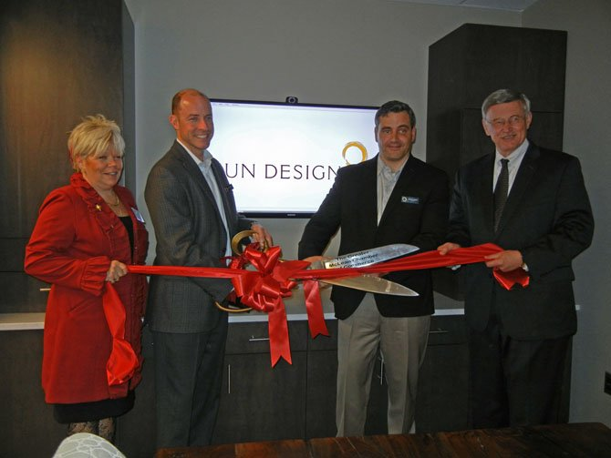 Seen here, cutting a ribbon to open the new office are, from left: Marcia Twomey, president of the Chamber; Craig Durosko, founder and chairman of Sun Design; Bob Gallagher, president of Sun Design; and John Foust, member of the Fairfax Country Board of Supervisors. Sun Design recently was named, for the second year in a row, among the region's best places to work.