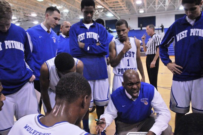 West Potomac boys basketball David Houston III talks to the Wolverines during their Dec. 11 victory against T.C. Williams.