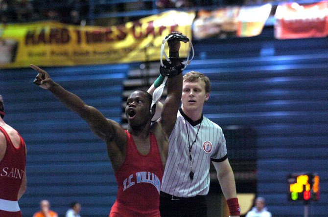T.C. Williams senior Ibrahim Bunduka acknowledges the crowd after winning the 126-pound title at the NOVA Classic wrestling tournament on Dec. 8 at Fairfax High School.