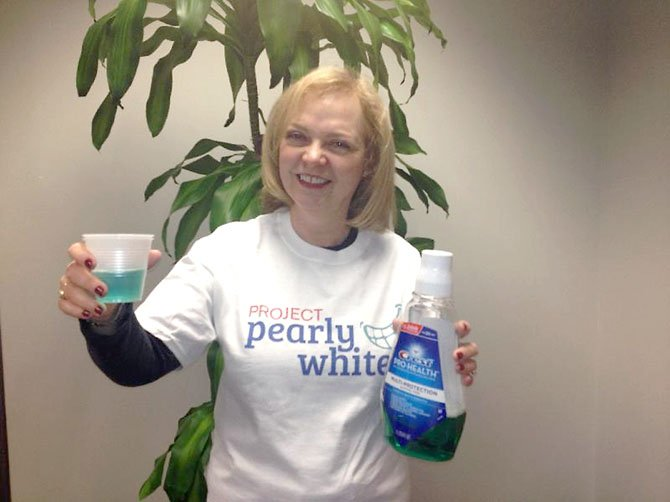 Margery Leveen Sher, executive director of the Medical Care for Children Partnership Foundation, raises a toast to children's dental health as the foundation launches Project Pearly Whites to raise $24,000 by the end of the year to provide dental care for 40 children.