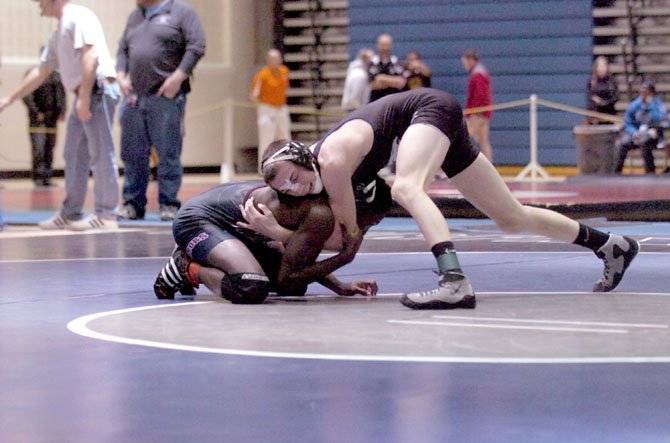 South Countys Hunter Manley won the 120-pound title at the 2012 FinalAutoPrice.com NOVA Classic on Dec. 8 at Fairfax High School.
