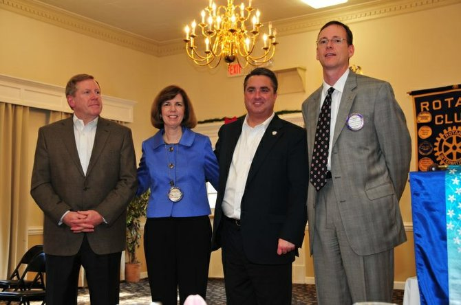 Fairfax City Mayor Scott Silverthorne (second from right) is joined by Rotarians Bob Sisson, Paula Kelley and Sean OConnell. 