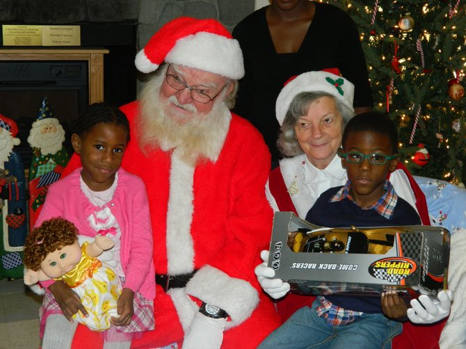 The Easter Seals Respite Program makes Saturdays a little brighter for families like the Heywards. Imani, 4, and Jeremy, 6, pose with Santa and Mrs. Claus.
