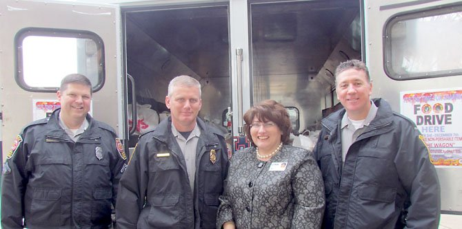 MPO Jim Reid (crime prevention officer, Franconia District Station), Captain Jim Baumstark (commander, Franconia District Station), Greenspring Associate Executive Director Lynn Keefe, Lieutenant Jake Jacoby (assistant commander, Franconia District Station).