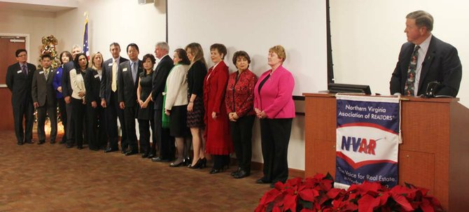 The 2013 Northern Virginia Association of Realtors Board of Directors and officers, from left: Mario Rubio, chairman-elect, with Rubio Real Estate in Annandale; Thai Hung Nguyen with Westgate Realty Group in Falls Church; Heather Embrey with McEnearney Associates in McLean; Bob Adamson with McEnearney Associates in Arlington; Lorraine Arora with Coldwell Banker in Arlington; Julia Avent with RE/MAX Allegiance in Arlington; Brian Block with RE/MAX Allegiance in McLean; Moon Choi with RE/MAX Presidential in Fairfax; Tracy Comstock with Comstock Realty in McLean; Virgil Frizzell with Long & Foster Real Estate in Reston; Suzanne Granoski with Keller Williams Realty in Alexandria; Christine Richardson with Weichert Realtors in Great Falls; Nancy Harvey Steorts with Long and Foster Real Estate in McLean; Mary Bayat, secretary/treasurer, with Bayat Realty in Alexandria; Pat Kline, immediate past chairman, with Avery Hess Realtors in Springfield; and Tom Stevens, NVAR past chairman.