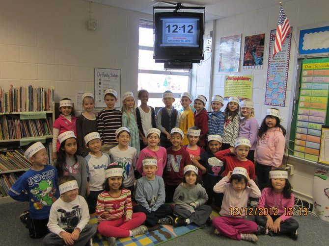 The Spring Hill Elementary School first grade class celebrated the last palindrome date of the century on Wednesday, Dec. 12 (12/12/12) at 12:12 p.m.