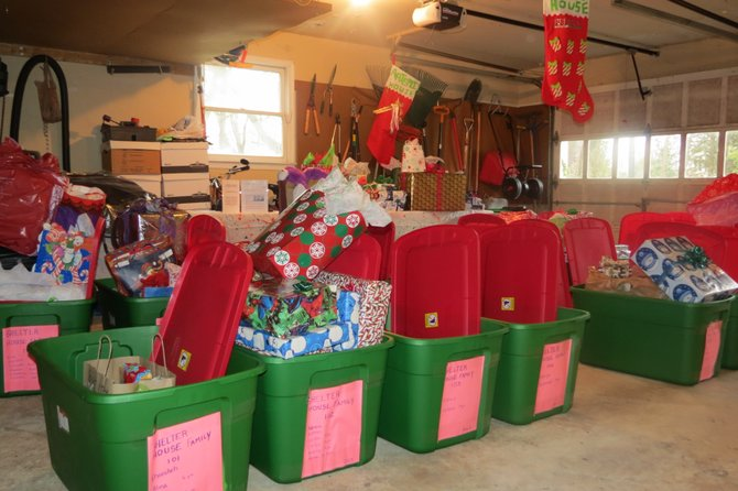 Bins filled the garage with the names of the shelter and families posted on the front.