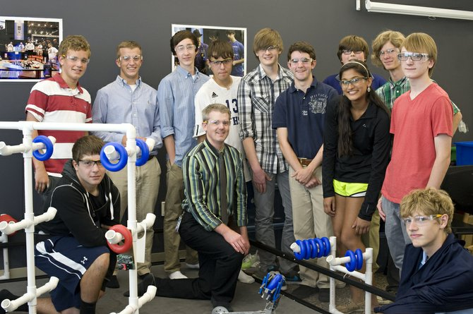 Robotics Team (from left): Scott Hamal, Malek Zahed, (kneeling), Jonny Howard, Evan Wilcox, Head Coach Michael Snyder (kneeling), Ian Schmidt, Christopher Salmon, Brian Clark, Nick Cerruti, Tanvi Bansal, (in front of Nick), Sky Leonard, Thomas Briggs, Cooper Overholt (lower right corner).
