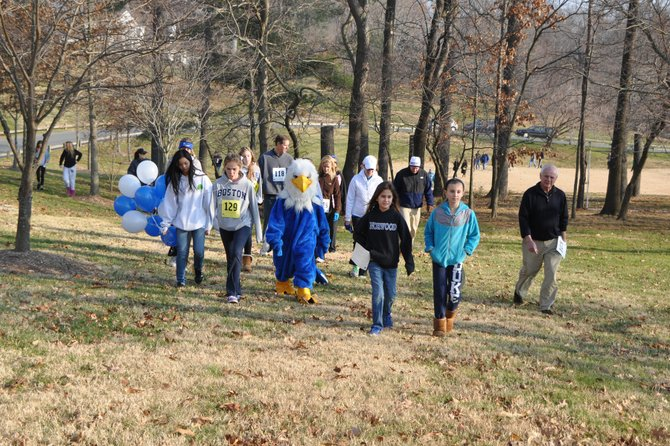More than 200 Norwood School students, parents, teachers, and staff walked the school's Potomac campus to raise money for K-8 schools devastated by Hurricane Sandy in New York City.