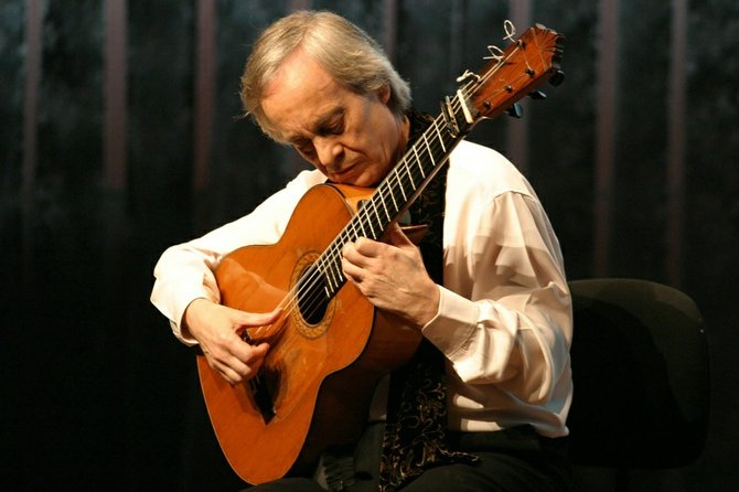Paco Peña, Flamenco guitarist, playing his guitar.