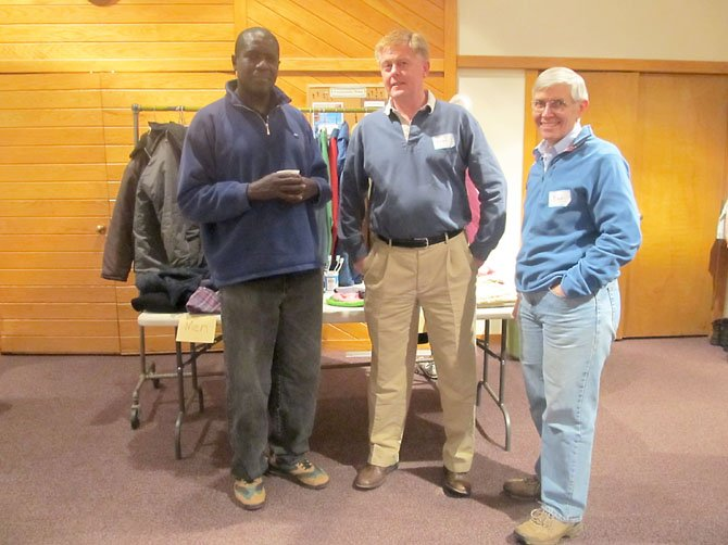 Musa, Braddock Supervisor John Cook, and Bill Murray at the check-in area for the hypothermia prevention shelter provided by Burke United Methodist Church on Friday, Dec. 21.