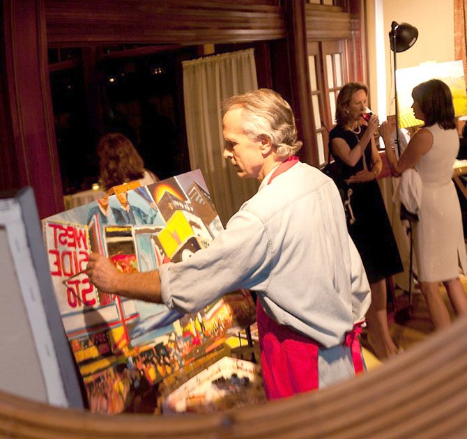Bob Gilbert in a mirror at an art auction.