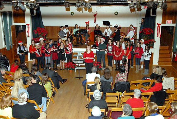 Cooper Middle School students sing Christmas Carols at the concert held at the historic Great Falls Grange on Dec. 12.