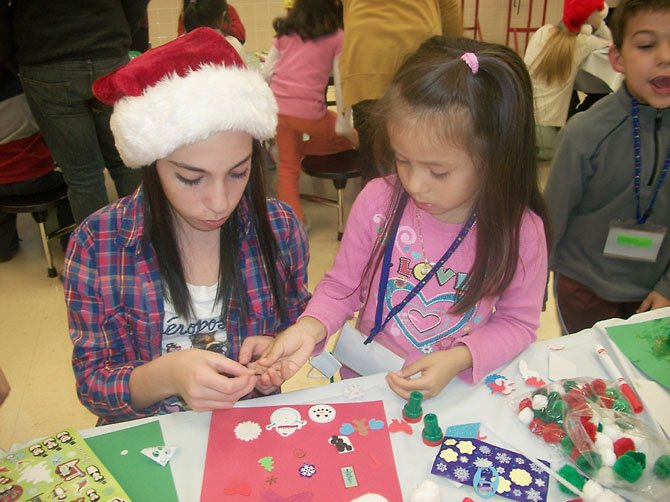 Cooper Middle School students helped the kindergarteners make cards for their families.