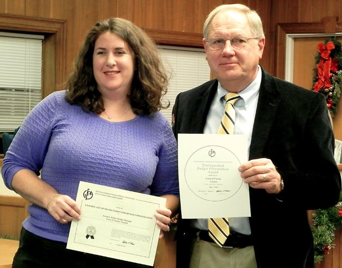 Gwen Riddle, budget manager, and Phil Grant, former finance director, receive the Certificate of Recognition for Budget Presentation at the Dec. 3 Town Council meeting.