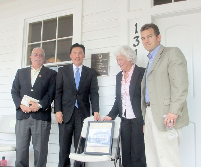 U.S. Congressman Gerry Connolly, Delegate to Virginia Assembly Mark Keam of Vienna, Vienna Mayor M. Jane Seeman and State Senator Chap Petersen celebrate the Freeman Store's designation as a Virginia historic landmark at the April 21, 2012, plaque unveiling.