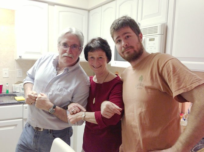 "Fairfax County Board of Supervisors Chairman Sharon Bulova  --aka ""The Turkey Master""--pictured with her sous chefs: nephew, Jesse Horneber (right) and brother-in-law, Dave Koss (left). Bulova spent the holidays in Ocean City with 13 relatives. ""I am the family Turkey Master. I love to cook but don't get enough chance to 'nurture' a big meal. Cooking turkey with my sausage and veggie dressing with grav"