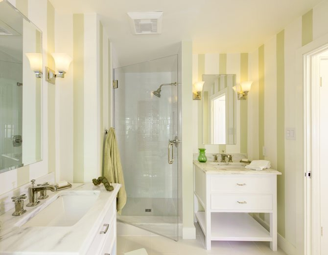 "Designer, and Arlington resident, Allie Mann created this bathroom using subway shower tiles, porcelain flooring and bright marble counters paired with polished nickel fixtures. Mann says this bathroom was one of her favorite accomplishments in 2012 ""because it blends casual comfort with casual elegance."""