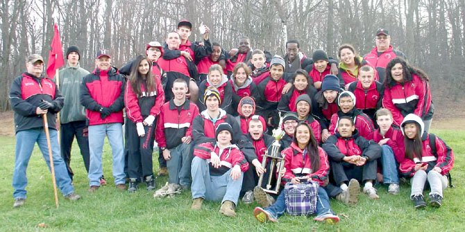 Herndon High's NJROTC cadets celebrate earning fourth place at the Area Five Orienteering Championship.