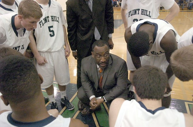 Flint Hill boys' basketball coach Rico Reed speaks to the Huskies during a Jan. 5 contest against Bishop Ireton.