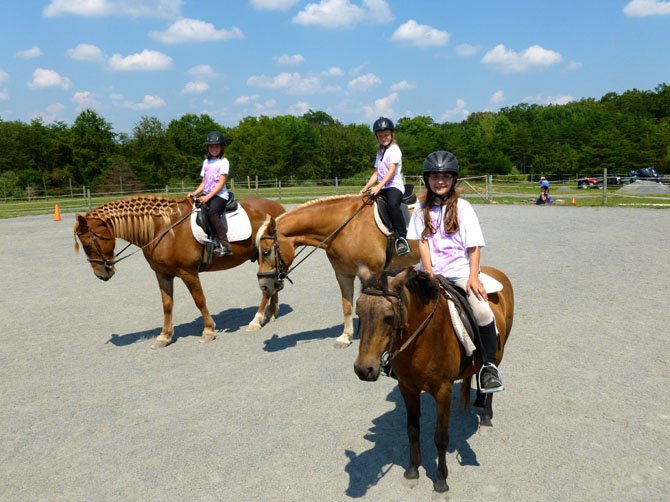 On horseback are (from left) riders Sophia Edwards, Penelope Edwards and Katie Puckett.